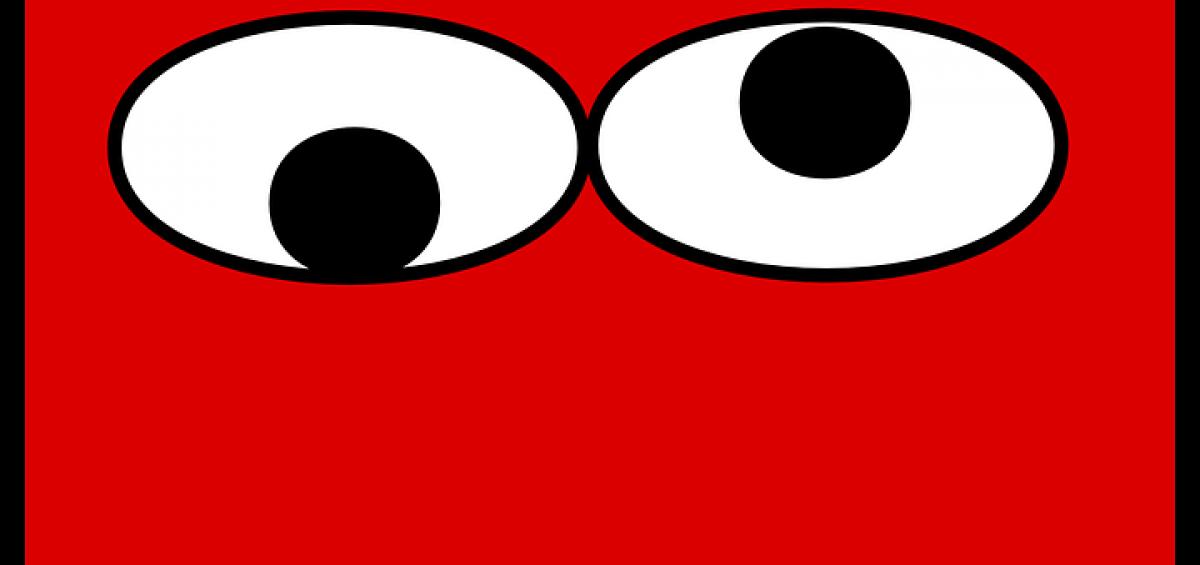ojos sobre fondo rojo